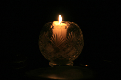 A candle against the dark night