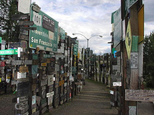 The Signpost Forest, international assemblage of street signs and license plates, Watson Lake, Yukon